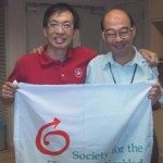 David and TingSern at the expedition kick-off with the SPD flag
